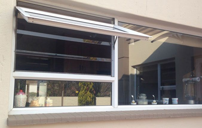window with clear poly carb burglar bars