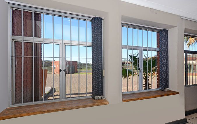 windows with stell round burglar bars