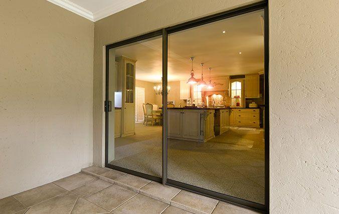 sliding door with kitchen in background