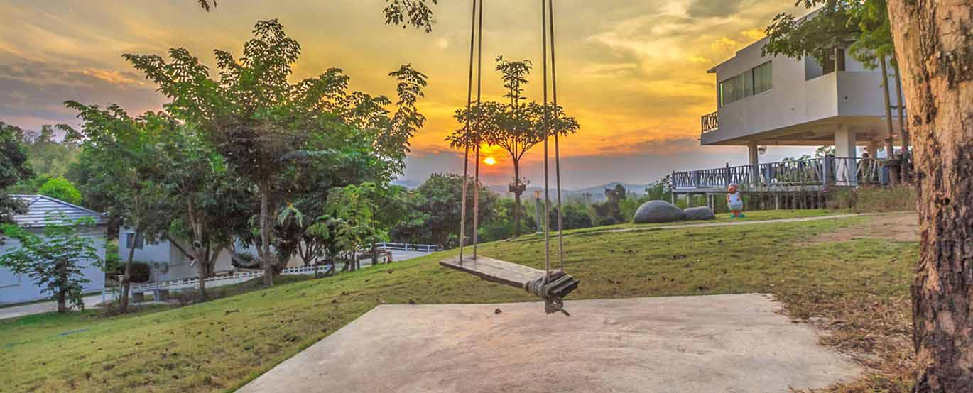 Swing with sun setting in background